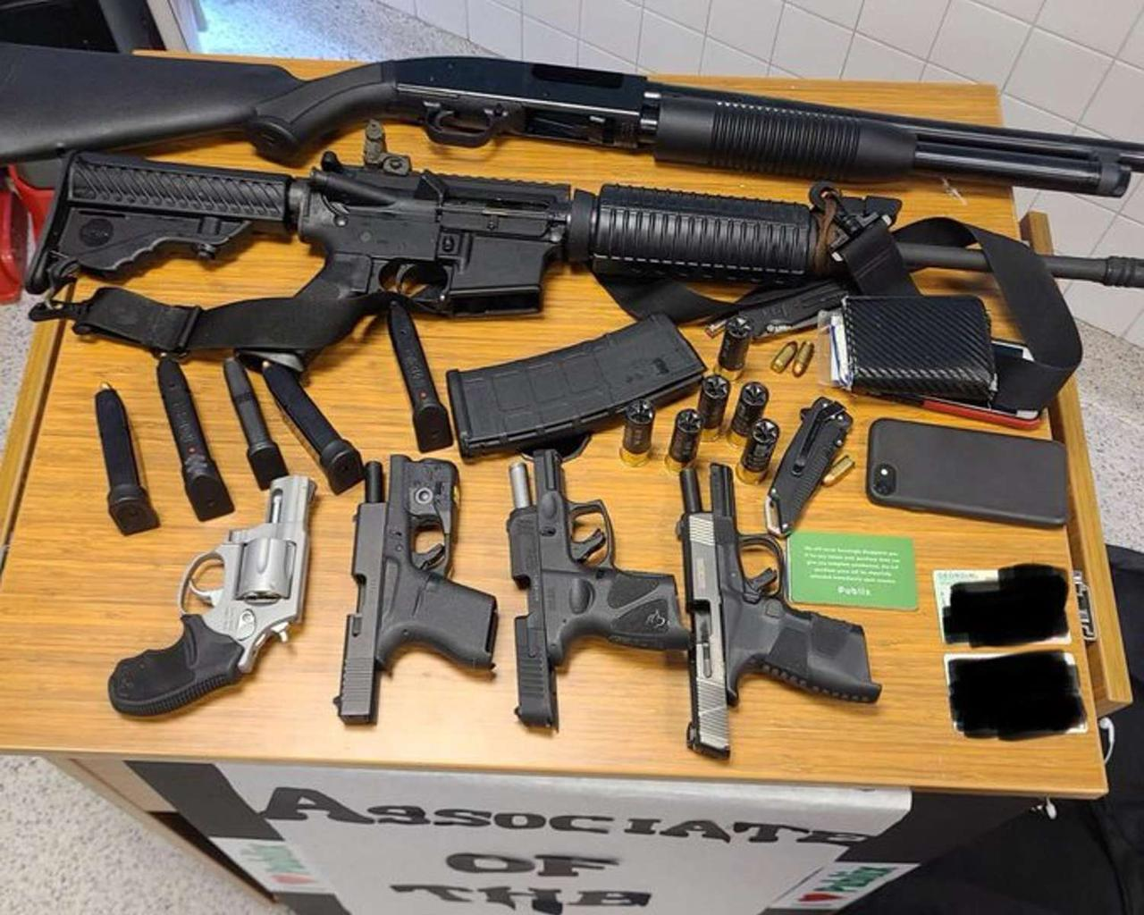 A man was arrested at an Atlanta store with six firearms, body armor, police said