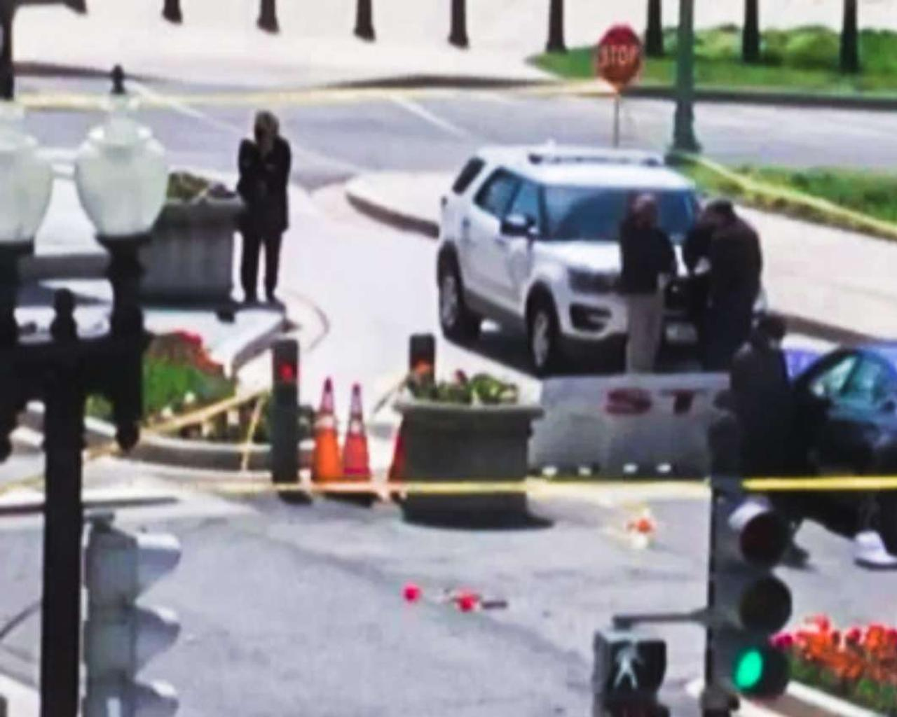 An attacker ran over two guards in front of the Capitol in Washington and was later killed by police.